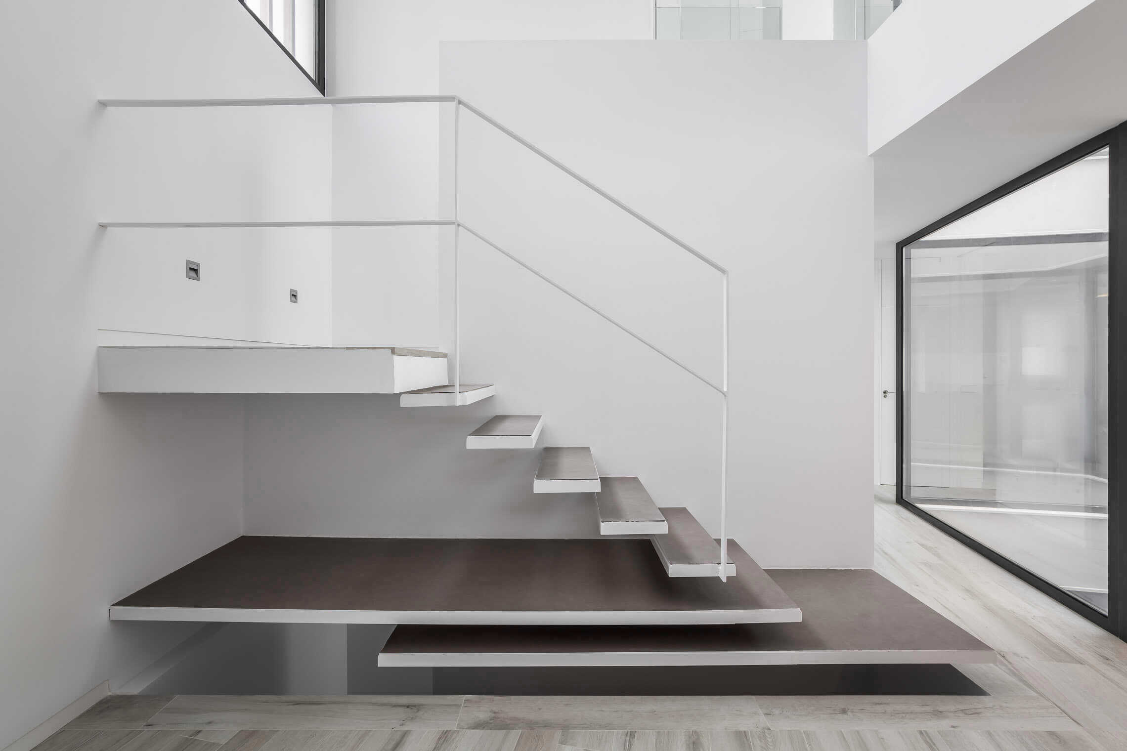 Laminate porcelain tile for steps of a staircase